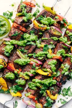 Grilled Steak Fajita Skewers with Avocado Chimichurri are perfectly seasoned tender and juicy steak skewers with bell peppers. The Avocado Chimichurri is the perfect dipping sauce to these skewers making the best summer meal! Good Steak Recipes, Pork Rib Recipes, Grilled Steak Recipes, Beef Recipes For Dinner, Healthy Diet Recipes, Grilled Meat, Grill Recipes, Meat Recipes, Grilled Steaks