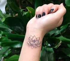 10 Minimalist Tattoo Designs For Your First Tattoo - Spat Starctic Lotus Tattoo Design, Lotus Flower Tattoo Wrist, Red Lotus Tattoo, Small Lotus Tattoo, Small Flower Tattoos, Lotus Tatoos, Hand Tattoos, Wrist Tattoos For Guys, Neue Tattoos