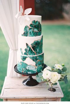 The rich jewel-toned green of malachite inspired this design