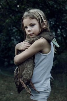 Girl with her pet duck...