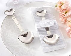 """A heart at the bottom, a heart at the top, and sweet love meets in the middle. You can't measure the charming impact this handy wedding or bridal shower favor will have on your guests. Even the smallest amount of love makes a big difference--and this gift of gratitude is no exception. Features and facts:Stainless-steel measuring spoon with a heart that measures a half teaspoon and a heart that measures one teaspoonMeasuring spoon measures 5"""" l x 1 5/8"""" wClear display gift box has a…"""