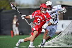 NCAA Lacrosse. Cornell's Rob Pannell comes around the cage hard