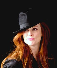 Black Fedora just sets off that Red Hair