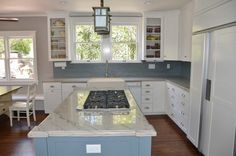 White shaker cabinets with blue bubway tile Lotus, White Shaker Cabinets, Tile, Kitchen, Design, Home Decor, White Dressers, Cuisine, Homemade Home Decor