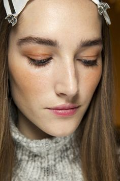 Spring 2015 beauty - The look at Pucci was inspired by the Seventies, with Lisa Butler applying an orange-brown shade to the eyes and cheekbones for definition, keeping skin dewy.