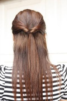 Quick Everyday Half-Do. Easy, just put some up from each side with a rubber band, leaving space inbetween, then flip the ponytail through the space so it looks like it's twisted.