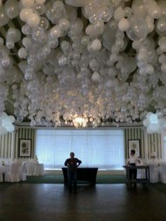 Ceiling Decorations! Helium Balloons inflated, float to ceiling. When they lose air, they slowly fall back down.