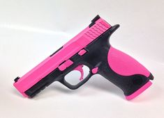 This is a Hogue pink Smith & Wesson M&P 9mm Handgun. Great for home defense! - www.tzarmory.com
