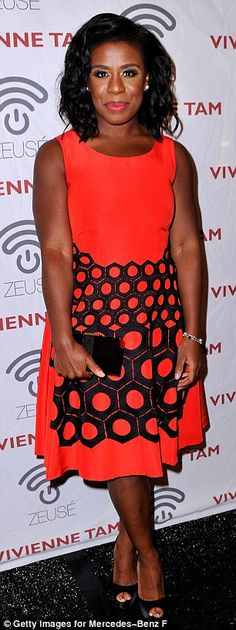 Uzo Aduba wore a bright orange frock featuring a funky black pattern resembling a honeycomb, teamed with black peep-toe pumps for the Vivienne Tam runway show at #NYFW http://dailym.ai/1qAefd7