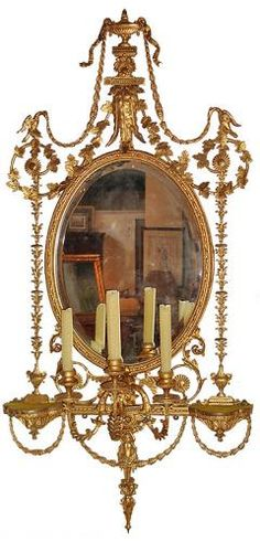 Girandole (pronounced JEER-on-dole) can mean one of three different things: A candelabra with multiple ornamental branches; An elaborate . Antique Frames, Antique Mirrors, Antiques Roadshow, San Francisco, Mirrored Furniture, Beautiful Mirrors, Interior Lighting, Candlesticks, Wall Sconces