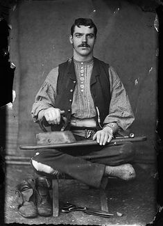 Occupational photograph of a tailor, ca. 1875.