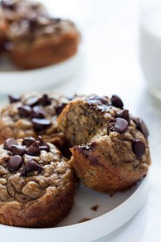 Banana muffins made with whole wheat flour, vanilla flavored protein powder, and a few chocolate chips because YES! Easy-to-make and ready in 30 minutes from start to finish!