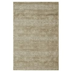 With an antiqued trellis motif in taupe, this elegant art silk rug anchors your seating group or creates an elegant focal point in your master suite.