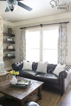 I love the shelves next to the fireplace and the window panel curtains!  #dothis