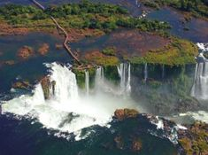 Travel to South America & Tour Iguazu Falls, the most stunning waterfalls in the world. Iguazu Falls Tours will connect you with wildlife & adventure. Largest Waterfall, Argentina Travel, Boarders, Strand, Wonders Of The World, Worlds Largest, Around The Worlds, The Incredibles, Usa