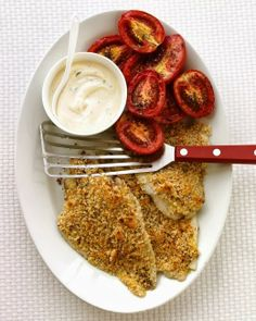 Baked Flounder with Roasted Tomatoes   Here Dijon mustard serves a dual purpose: It flavors the delicate fish, and helps the breadcrumb coating stay in place as the fish cooks. Tilapia can be used in place of the flounder.
