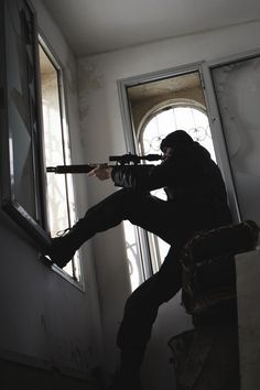 """""""Go on down, I'll cover you!"""" BANG. He fired out the window, and Archer jumped down the steps banging his elbow against the wall. """"Ben!"""" He yelled pulling his rifle off his shoulder and putting his eye to the scope. """"I'm good, you can come down."""""""