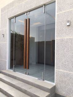 Glass door with wooden handle: