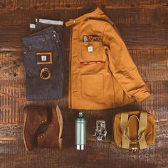 Outfit Grid. Flay Lay. Outfit of the day.  Photo: Brandon Burk Photography Chore Coat and Wallet: Pointer Brand Denim: Freenote Cloth Leather Cuff: Billykirk Boots: Wolverine Heritage Collection Thermos: STANLEY Cooler: Filson Handkerchief: Pendleton Woolen Mills Knife: Chris Reeve Knives  @wolverine1000 @lckingmfg @freenotecloth @stanleybrand @filsonco #filsonlife #ruggedstyle #rawdenim #reclaimedwood #leathergoods BrandonBurkPhotography.com