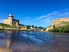 Two castles, one in Estonia (l) and one in Russia (r) face off over the Narva River.