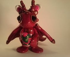 Dark Red Dragon with Copper accents with Easter by TheDragonsMark
