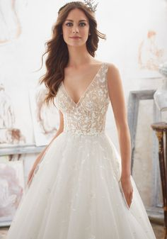 Morilee by Madeline Gardner 'Matilda' 5515 | Crystal Beaded Floral Embroidery Accent the Illusion Bodice and V Back on This Classic Tulle Ballgown Creating a Soft, Romantic Look. Colors Available: White, Ivory, Nude/Ivory. Shown in Nude/Ivory.