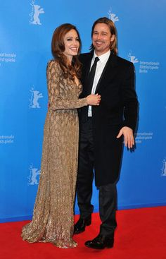 Brad Pitt and Angelina Jolie, in a gold gown, at the Berlin Film Festival