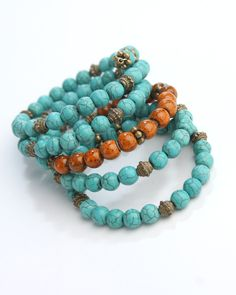 Vi Bella Jewelry - Shelly Bracelet - What a great look!  The Shelly Bracelet is made of crackled orange and turquoise beads, accented with antique bronze Tibetan style beads all strung on memory wire.  Perfect with the Shelly Necklace and earrings.      Length - Memory Wire on size fits all.     Handcrafted by Vi Bella Artists in Haiti.  $26.95