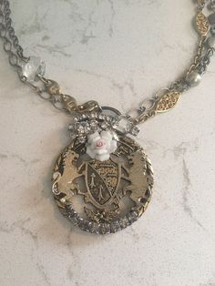 A personal favorite from my Etsy shop https://www.etsy.com/listing/524025541/lions-coat-of-arms-repurposed-necklace