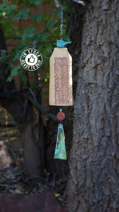 Ceramic Wind Chimes Garden Bell Handmade Gift Bluebird of Happiness Garden Art Rustic Patio Decor Chime Garden Gifts Windchime Autumn Decor. This handmade mixed ceramic wind chime garden bell features a beautiful carved starburst pattern, accented by a large copper wind sail with a patina finish. A small ceramic sculpture of a blue bird sits atop. My wind chimes serve so many purposes, besides just beautiful garden décor. They alert you to the severity of the wind that day, will scare off...
