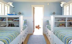 Kids' Bedroom - In the children's bedroom, two rows of beds put a whimsically nautical spin on the traditional bunk.