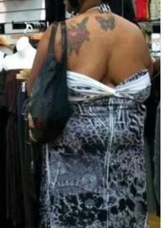 Walmart People- FAIL She has her dress on backwards.