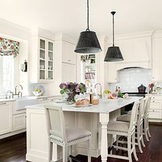 Island seating - indent cabinets for additional bar stools on each side  Lighten Up Kitchen Update - Southern Living Mobile