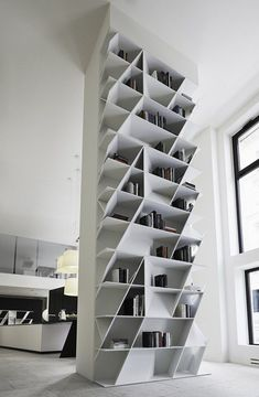 For years the only acceptable way to store our books was in a classical box-like unit known simply as a bookcase. Geometric bookcases and wall units come in a large variety of designs. The WEB bookcase was designed by Daniel Libeskind and perfectly suits a modern lifestyle. The bookcase is, in fact, a versatile and multifunctional piece which can be used for much more than just book storage. In addition, its strong visual impact allows it to beco