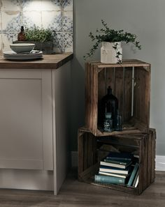 Vintage apple crates provide the perfect storage area for cookery books in your Shaker style kitchen. Be inspired by Howdens.