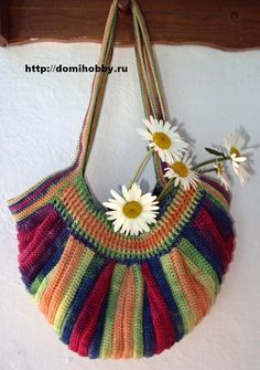 Wonderful crocheted bag from a Russian site. Made using a variegated yarn.