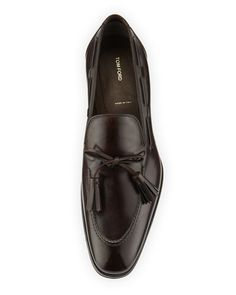 Tom Ford calf leather tassel-tie loafer. 360-degree lacing. Stacked flat heel…