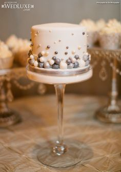 WedLuxe: sweet silver and white cakes