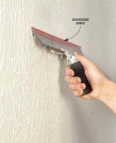 I hate the textured walls in the kitchen  Trevor's room. Someday maybe i'll get around to doing this... How to skim coat walls (smoothing walls with a lot of damage or a textured paint job). Using prime first and a roller.