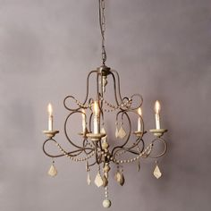 """Grand Iron and Wood Beaded Chandelier. 28.75"""" x 28.75"""" x 35"""" H. $498."""