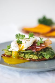 sweet potato toast with avocado, spinach, prosciutto and poached egg