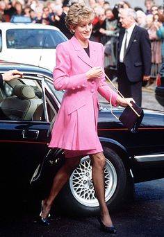 1993 | A hot-pink frock coat and matching skirt gave the newly-separated Diana a cheerful glow. | InStyle 16