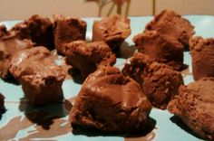 FUDGE (S)  ½ c coconut oil 4 oz cream cheese ½-3/4 c cream 2 oz unsweetened baking chocolate Truvia to taste  pinch of sea salt Throw everything but heavy cream in a pot, melt, and bring to a light boil for a minute or so. Dump in a blender and toss in the heavy cream. Blend until cream causes the mixture to be thick and creamy. Enjoy as a rich pudding! Or chill as delicious fudge! Or freeze as a huge milk chocolate bar!