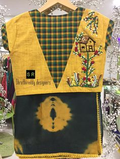 Beautiful designer saree and yellow and green color combination designer blouse with house design hand embroidery thread work. 17 March 2018