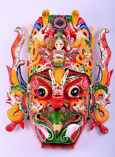 """'Hand carved and hand painted wooden mask. Used to perform tribal dances in Chinese Di opera. The featured mask is the Thunder God as know as """"Lei Gong"""". He is half bird half man. http://www.pinterest.com/niveusghost/mask/"""