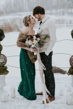 Emerald green is a stunning non-traditional wedding dress for a winter bride. The color against a snowy backdrop is perfection. Add a fur wrap with a neutral colored bouquet to incorporate earthy tones. Your groom can boast a stylish sweater to give your photos a warm and cozy feel.