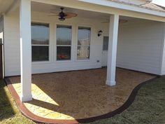 Simple patio cover and stamped concrete, via Flickr.
