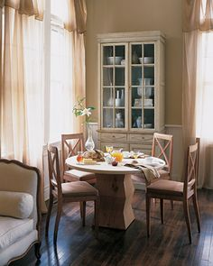 Subtle variations of the color cream fill this soothing breakfast room.
