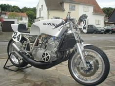 Suzuki GT750 aka Water Buffalo. Not quite as evil as the H2 Kawasaki but still pretty wild by today's standards.  Be interesting to ride one like this with chassis work.