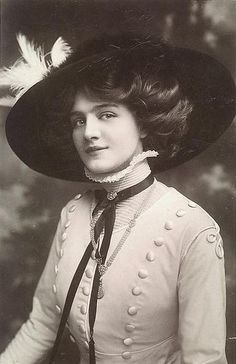 Lily Elsie.  The buttons on the suit, the braid, the Merry Widow hat she made famous, all of it - gorgeous.